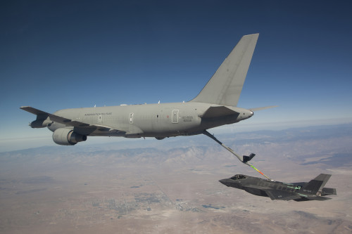 """An American JSF AF-4 from the 461 FLTS, Edwards AFB, CA, piloted by Maj. Charles """"FLAK"""" Trickey performs the first contact and fuel transfer from a KC-767 foreign partner Italian Tanker."""