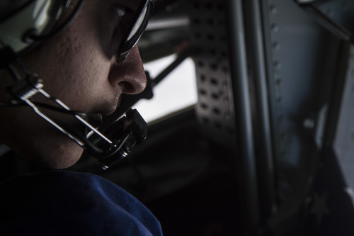 U.S Air Force Airman 1st Class Nicholas Sowder flies on a KC-135 Stratotanker over the Arabian Sea, Jan. 27, 2016. Sowder is a boom operator deployed out of the 351st Air Refueling Squadron in RAF Mildenhall, England. (U.S. Air Force photo by Staff Sgt. Corey Hook/Released)