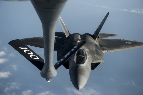 A U.S. Air Force F-22 Raptor approaches a USAF KC-135 Stratotanker for fuel over the Arabian Sea in support of Operation Inherent Resolve, Jan. 27, 2016. The F-22 is a fifth-generation aircraft and is designed to engage in air-to-air and air-to-ground missions. (U.S. Air Force photo by Staff Sgt. Corey Hook/Released)