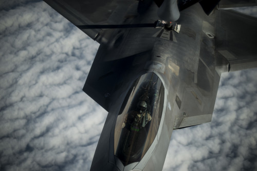 A U.S. Air Force F-22 Raptor receives fuel from a USAF KC-135 Stratotanker over the Arabian Sea in support of Operation Inherent Resolve, Jan. 27, 2016. The F-22's combination of sensor capability, integrated avionics, situational awareness, and weapons provides first-kill opportunity against threats. (U.S. Air Force photo by Staff Sgt. Corey Hook/Released)