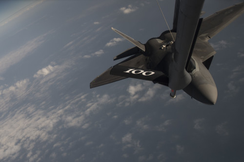 A U.S. Air Force F-22 Raptor receives fuel from a USAF KC-135 Stratotanker over the Arabian Sea in support of Operation Inherent Resolve, Jan. 27, 2016. OIR is the coalition intervention against the Islamic State of Iraq and the Levant. (U.S. Air Force photo by Staff Sgt. Corey Hook/Released)