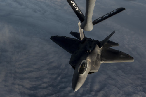 A U.S. Air Force F-22 Raptor descends after receiving fuel from a USAF KC-135 Stratotanker over the Arabian Sea in support of Operation Inherent Resolve, Jan. 27, 2016. The F-22's combination of sensor capability, integrated avionics, situational awareness, and weapons provides first-kill opportunity against threats. (U.S. Air Force photo by Staff Sgt. Corey Hook/Released)