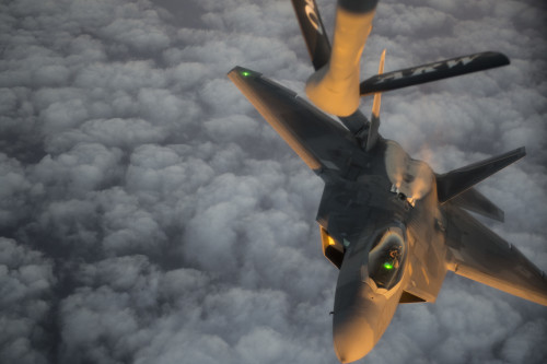 A U.S. Air Force F-22 Raptor descends after receiving fuel from a USAF KC-135 Stratotanker over the Arabian Sea in support of Operation Inherent Resolve, Jan. 27, 2016. The F-22 is a fifth-generation aircraft and is designed to engage in air-to-air and air-to-ground missions. OIR is the coalition intervention against the Islamic State of Iraq and the Levant. (U.S. Air Force photo by Staff Sgt. Corey Hook/Released)