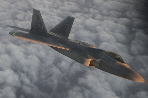 A U.S. Air Force F-22 Raptor flies over the Arabian Sea in support of Operation Inherent Resolve, Jan. 27, 2016. The F-22's combination of sensor capability, integrated avionics, situational awareness, and weapons provides first-kill opportunity against threats. (U.S. Air Force photo by Staff Sgt. Corey Hook/Released)