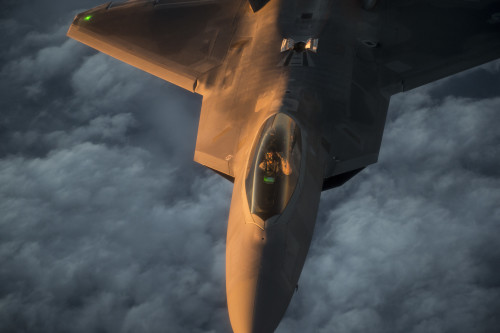 A U.S. Air Force F-22 Raptor flies over the Arabian Sea in support of Operation Inherent Resolve, Jan. 27, 2016. The F-22 is a fifth-generation aircraft and is designed to engage in air-to-air and air-to-ground missions. OIR is the coalition intervention against the Islamic State of Iraq and the Levant.  (U.S. Air Force photo by Staff Sgt. Corey Hook/Released)