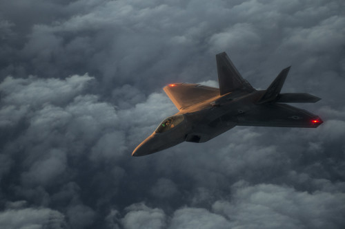 A U.S. Air Force F-22 Raptor flies over the Arabian Sea in support of Operation Inherent Resolve, Jan. 27, 2016. The F-22's combination of sensor capability, integrated avionics, situational awareness, and weapons provides first-kill opportunity against threats. OIR is the coalition intervention against the Islamic State of Iraq and the Levant.  (U.S. Air Force photo by Staff Sgt. Corey Hook/Released)