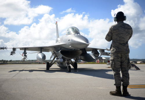 A crew chief assigned to the 35th Aircraft Maintenance Squadron, Misawa Air Base, Japan, prepares an F-16 Fighting Falcon, piloted by 1st Lt. Dave Takahashi, 13th Fighter Squadron, for takeoff Feb. 4, 2016, at Andersen Air Force Base, Guam.  Several F-16 Fighting Falcons from the 13th FS are deployed to Andersen AFB in support of Cope North 2016. Cope North is an annual event that focuses on humanitarian assistance and disaster relief and large force employment in an effort to enhance interoperability among forces from the U.S., Japan, Australia, South Korea, Philippines and New Zealand. (U.S. Air Force photo/Senior Airman Joshua Smoot)