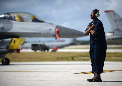 Senior Airman Darion Hubbard, a 35th Aircraft Maintenance Squadron assistant dedicated crew chief from Misawa Air Base, Japan, prepares an F-16 Fighting Falcon for takeoff Feb. 4, 2016, at Andersen Air Force Base, Guam. Several F-16s from the 13th FS are deployed to Andersen AFB in support of Cope North 2016. Cope North is an annual event that focuses on humanitarian assistance and disaster relief and large force employment in an effort to enhance interoperability among forces from the U.S., Japan, Australia, South Korea, Philippines and New Zealand. (U.S. Air Force photo/Senior Airman Joshua Smoot)