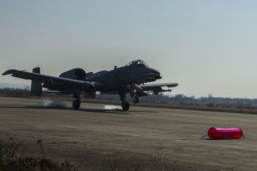 A 74th Expeditionary Fighter Squadron A-10C Thunderbolt II aircraft lands on an unimproved surface during an austere landing training exercise at Plovdiv, Bulgaria, Feb. 9, 2016. The rugged surface conditions of the runway allow pilots to closely simulate possible landing conditions in a deployed environment. (U.S. Air Force photo by Airman 1st Class Luke Kitterman/Released)