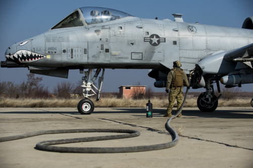 A member of the 100th Logistics Readiness Squadron refuels a 74th Expeditionary Fighter Squadron A-10C Thunderbolt II aircraft during forward area refueling point training at Plovdiv, Bulgaria, Feb. 9, 2016. A single A-10 usually receives approximately 2000 pounds of fuel in a 5-7 minute span during FARP training. (U.S. Air Force photo by Airman 1st Class Luke Kitterman/Released)