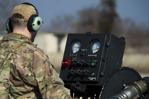 A member of the 67th Special Operations Squadron watches gages on a forward area manifold cart while refueling a 74th Expeditionary Fighter Squadron A-10C Thunderbolt II aircraft during forward area refueling point training at Plovdiv, Bulgaria, Feb. 9, 2016. A single A-10 usually receives approximately 2000 pounds of fuel in a 5-7 minute span during FARP training. (U.S. Air Force photo by Airman 1st Class Luke Kitterman/Released)