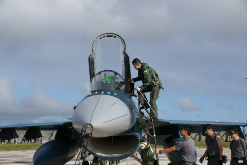 Japanese Air Self-Defense Force Maj. Hirofumi Egusa, 3rd Fighter Squadron, climbs into the cockpit of a JASDF F-2 aircraft during Cope North 16, Andersen Air Force Base, Guam, Feb. 11, 2016. Japanese forces are among the 22 total flying units and nearly 3,000 personnel from six countries participating in CN16. The exercise aims to grow strength, interoperability and beneficial relationships within the Indo-Asia-Pacific region through integration of airborne and land-based command and control assets. (Japanese Air Self-Defense Force photo by Sgt. Masahiro Kobayashi/Released)