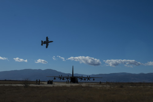 A 74th Expeditionary Fighter Squadron A-10C Thunderbolt II aircraft flies over an MC-130J Commando II aircraft, assigned to the 67th Special Operations Squadron, during a training exercise at Plovdiv, Bulgaria, Feb. 11, 2016. The aircraft deployed to Bulgaria in support of Operation Atlantic Resolve to bolster air power capabilities while assuring the U.S. commitment to European security and stability. (U.S. Air Force photo by Airman 1st Class Luke Kitterman/Released)