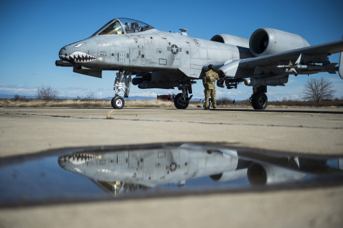 A member of the 100th Logistics Readiness Squadron refuels a 74th Expeditionary Fighter Squadron A-10C Thunderbolt II aircraft during forward area refueling point training at Plovdiv, Bulgaria, Feb. 11, 2016. A single A-10 usually receives approximately 2000 pounds of fuel in a 4-5 minute span during FARP training but the C-130 can provide tens of thousands of pounds of fuel if needed. (U.S. Air Force photo by Airman 1st Class Luke Kitterman/Released)