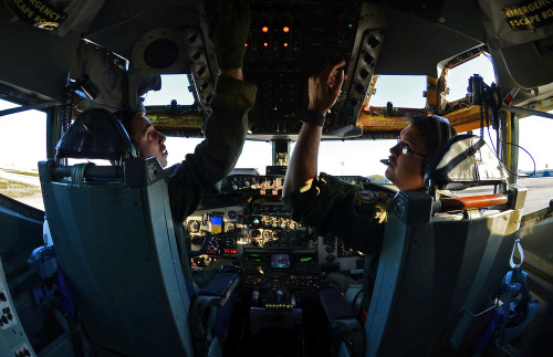 U.S. Air Force Capts. Scott Carlan, left, and Jack Ryan, 351st Expeditionary Air Refueling Squadron KC-135 Stratotanker pilots, prepare to depart Istres-Le Tubé Air Base, France, Feb. 26, 2016. Three KC-135 Stratotankers, along with 50 Airmen from the 100th Air Refueling Wing, are providing air refueling and airlift support to French operations in Mali and North Africa in support of Operation Juniper Micron. (U.S. Air Force photo by Senior Airman Erin Trower/Released)