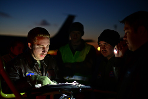U.S. Air Force service members assigned to RAF Mildenhall, England, review flight plans on the flight line at Istres-Le Tubé Air Base, France, Feb. 26, 2016. Since 2013, the U.S has been supporting the French government in Operation Juniper Micron by providing air refueling and airlift support of French operations in Mali and North Africa. (U.S. Air Force photo by Senior Airman Erin Trower/Released)