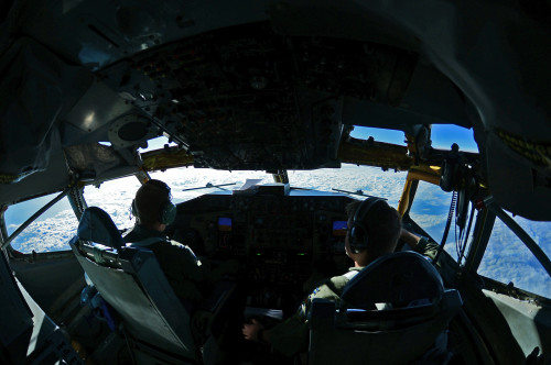 U.S. Air Force Capts. Scott Carlan, left, and Jack Ryan, 351st Expeditionary Air Refueling Squadron KC-135 Stratotanker pilots, fly a refueling mission in support of Operation Juniper Micron over France, Feb. 26, 2016. Since 2013, the U.S has been supporting the French government in OJM by providing air refueling and airlift support of French operations in Mali and North Africa. (U.S. Air Force photo by Senior Airman Erin Trower/Released)
