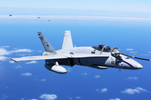 A Spanish Air Force F/A-18 Hornet with 462 Squadron refuels during an air-to-air refuel mission with a U.S. Marine Corps KC-130J with Marine Aerial Refueler Transport Squadron 252, Special-Purpose Marine Air-Ground Task Force-Crisis Response- Africa, Gran Canaria, Spain, Mar. 29, 2016. SPMAGTF-CR-AF Marines and Spanish airmen conducted air-to-air refueling missions in order to enhance crisis response readiness and help build relationships between the two militaries. (U.S. Marine Corps photo by Sgt. Kassie L. McDole/Released)