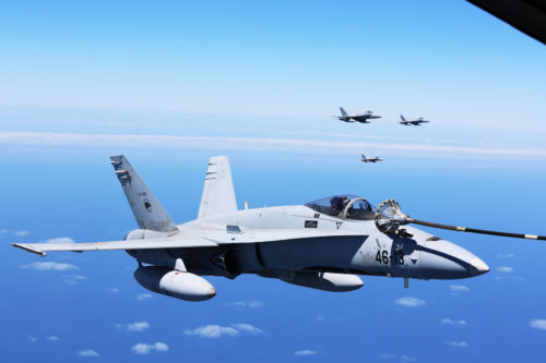 Spanish Air Force F/A-18 Hornets with 462 Squadron fly in formation during an air-to-air refuel mission with a U.S. Marine Corps KC-130J with Marine Aerial Refueler Transport Squadron 252, Special-Purpose Marine Air-Ground Task Force-Crisis Response- Africa, Gran Canaria, Spain, Mar. 29, 2016. SPMAGTF-CR-AF Marines and Spanish airmen conducted air-to-air refueling missions in order to enhance crisis response readiness and help build relationships between the two militaries. (U.S. Marine Corps photo by Sgt. Kassie L. McDole/Released)