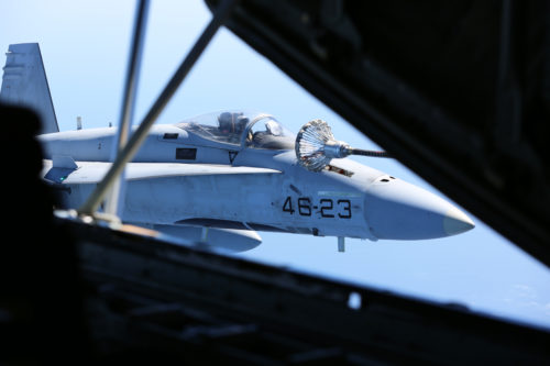 A Spanish Air Force F/A-18 Hornet with 462 Squadron receives fuel from a U.S. Marine Corps KC-130J with Marine Aerial Refueler Transport Squadron 252, Special-Purpose Marine Air-Ground Task Force-Crisis Response- Africa during an aerial refuel mission, Gran Canaria, Spain, Mar. 29, 2016. SPMAGTF-CR-AF Marines and Spanish airmen conducted air-to-air refueling missions in order to enhance crisis response readiness and help build relationships between the two militaries. (U.S. Marine Corps photo by Sgt. Kassie L. McDole/Released)