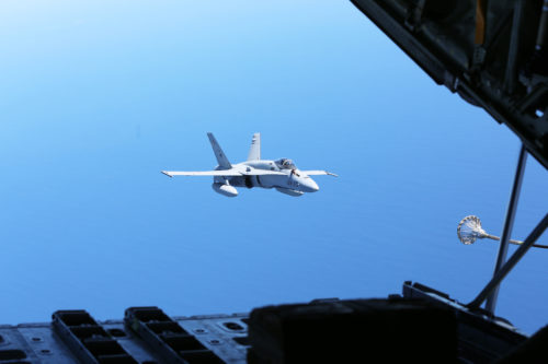 A Spanish Air Force F/A-18 Hornet with 462 Squadron prepares to receive fuel during an air-to-air refuel mission with a U.S. Marine Corps KC-130J with Marine Aerial Refueler Transport Squadron 252, Special-Purpose Marine Air-Ground Task Force-Crisis Response- Africa, Gran Canaria, Spain, Mar. 29, 2016. SPMAGTF-CR-AF Marines and Spanish airmen conducted air-to-air refueling missions in order to enhance crisis response readiness and help build relationships between the two militaries. (U.S. Marine Corps photo by Sgt. Kassie L. McDole/Released)