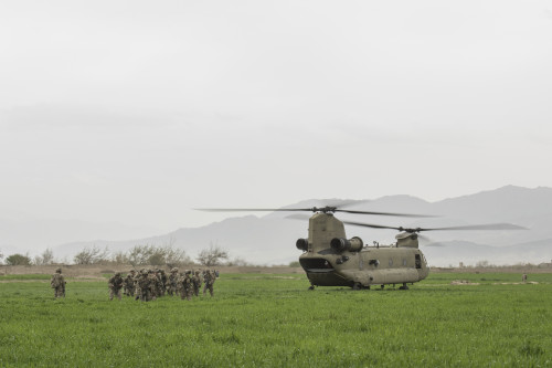 A CH-47 Chinook offloads soliders in Khanjar Khel, Parwan Province, Afghanistan, as part of the response to an F-16 Fighting Falcon crash just outside of Bagram Airfield, Afghanistan, March 30, 2016. The F-16 crashed after takeoff and the pilot safely ejected; since then, the base completed cleaning up the crash site. The cause of the accident is under investigation. (U.S. Air Force photo/Tech. Sgt. Robert Cloys)