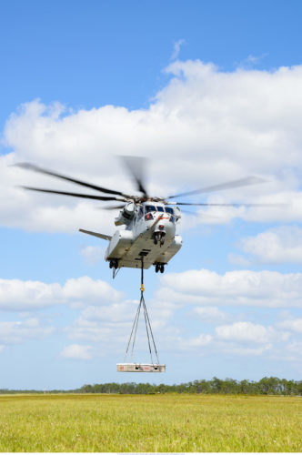 The CH-53K King Stallion helicopter achieves its first flight with an external load at Sikorsky's Development Flight Test Center in West Palm Beach, FL. (PRNewsFoto/Lockheed Martin)