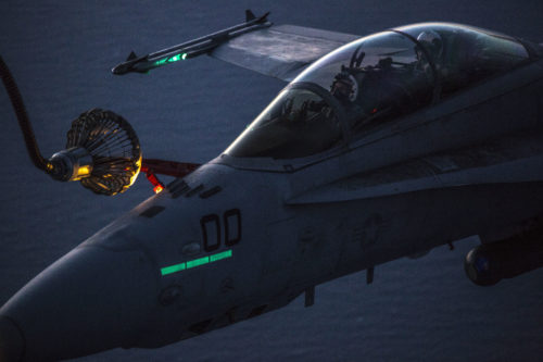 Marines with Marine Aerial Refueler Transport Squadron (VMGR) 152 and Marine All-Weather Fighter Attack Squadron (VMFA) 242 perform air to air refueling April 28, 2016. The units practiced both in the afternoon and at night to ensure maximum readiness in any scenario. (U.S. Marine Corps photo by Cpl. Nathan Wicks/Released)