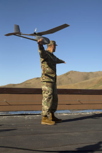U.S. Army SFC Bradley Godsey demonstrates the steps of launching an unmanned aerial vehicle May 27 during the UAV training portion of Khaan Quest 2016 at Five Hills Training Area near Ulaanbaatar, Mongolia. The training equipped MAF members with a deeper understanding of the purpose and operations of UAVs and how they can be used during peacekeeping missions. Khaan Quest 2016 is an annual, multinational peacekeeping operations exercise hosted by the Mongolian Armed Forces, co-sponsored by U.S. Pacific Command, and supported by U.S. Army Pacific and U.S. Marine Corps Forces, Pacific. Khaan Quest, in its 14th iteration, is the capstone exercise for this year's Global Peace Operations Initiative program. The exercise focuses on training activities to enhance international interoperability, develop peacekeeping capabilities, build to mil-to-mil relationships, and enhance military readiness. Godsey is a Clay City, Indiana, native, and is assigned to 8th military Police Brigade. (U.S. Marine Corps Photo by Cpl. Janessa K. Pon)