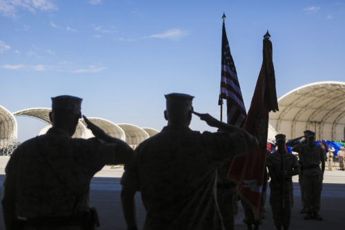 Sgt. Maj. Allen Goodyear, sergeant major of Marine Fighter Attack Squadron (VMFA) 211, and Col. Marcus Annibale, commanding officer of Marine Aircraft Group (MAG) 13, salute the colors during a re-designation and change of command ceremony aboard Marine Corps Air Station Yuma, Ariz., June 30. During the ceremony, Marine Attack Squadron (VMA) 211 transitioned to VMFA-211 making it the first AV-8B Harrier squadron to become an F-35B Lightning II Joint Strike Fighter squadron. (U.S. Marine Corps photo by Lance Cpl. Harley Robinson/Released.)