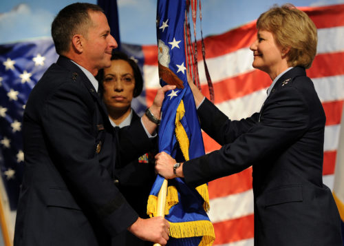 U.S. Air Force Chief of Staff, Gen. David L. Goldfein, passes the Air Force Reserve Command flag to Lt Gen. Maryanne Miller at the change of command ceremony at the Museum of Aviation, Warner Robins, GA, July 15, 2016. With the flag exchange, Miller became the first women to lead Air Force Reserve Command. (U.S. Air Force photo credite by Tech Sgt. Stephen D. Schester)