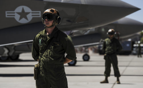 Corporal Highley, assigned to the 3rd Marine Aircraft Wing, Marine Corps Air Station Yuma, Az., prepares to marshal an F-35B during Red Flag 16-3 at Nellis Air Force Base, Nev., July 12, 2016. Red Flag is an exercise hosted at Nellis AFB that provides air crews an opportunity to experience realistic, stressful combat situations in a controlled environment to increase mission capability. (U.S. Air Force photo by Airman 1st Class Kevin Tanenbaum)