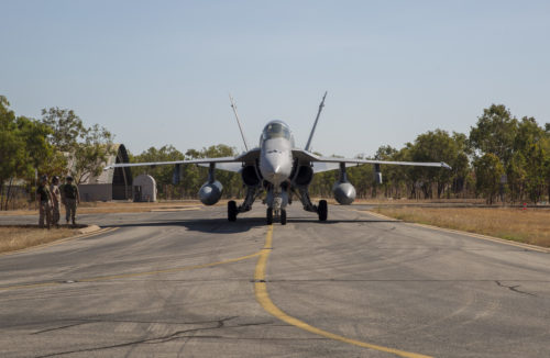 An F/A-18C Hornet with Marine Fighter Attack Squadron (VMFA) 122, forward deployed to Marine Corps Air Station Iwakuni, Japan, taxis into an ordnance loading area after landing at Royal Australian Air Force Base Tindal, Australia, July 21, 2016. VMFA-122 traveled to RAAF Base Tindal for the first time to participate in Pitch Black 2016 and unit level training known as Southern Frontier. Pitch Black affords Marines with VMFA-122 the opportunity to integrate and increase interoperability with regional joint and coalition partners, while developing operational concepts for conducting sustained combat operations. Southern Frontier will help the squadron gain experience and qualifications in low altitude, air-ground, high explosive ordnance delivery at the unit level. (U.S. Marine Corps photo by Cpl. Nicole Zurbrugg)