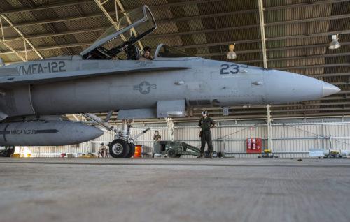 U.S. Marine Corps Maj. David Dunsworth, an F/A-18C Hornet pilot with Marine Fighter Attack Squadron (VMFA) 122, completes a preflight check as Lance Cpl. Luke Zeisloft, a powerline Marine assigned to VMFA-122, stands by during Southern Frontier at Royal Australian Air Force Base Tindal, Australia, Aug. 24, 2016. VMFA-122 provided close air support to ground units at Bradshaw Range Complex during the training. Southern Frontier is a three week unit level training evolution helping the flying squadron gain qualifications and experience in low altitude, air ground, high explosive ordnance delivery. (U.S. Marine Corps photo by Cpl. Nicole Zurbrugg)
