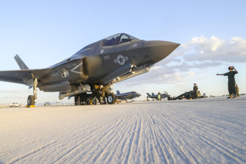 U.S. Marines with Marine Fighter Attack Squadron 121 (VMFA-121), 3rd Marine Aircraft Wing, conduct the first ever hot load on the F-35B Lightning II in support of Weapons and Tactics Instructor Course (WTI) 1-17 at Marine Corps Air Station Yuma, Ariz., Sept. 22, 2016. The exercise is part of WTI 1-17, a seven-week training event hosted by Marine Aviation Weapons and Tactics Squadron One (MAWTS-1) cadre. MAWTS-1 provides standardized tactical training and certification of unit instructor qualifications to support Marine Aviation Training and Readiness and assists in developing and employing aviation weapons and tactics. (U.S. Marine Corps photograph by SSgt. Artur Shvartsberg, MAWTS-1 COMCAM)
