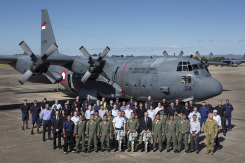 Tentara Nasional Indonesia-Angkatan Udara (TNI-AU) air crew stand with maintainers and RAAF Base Richmond senior leadership in front of TNI-AU's newly acquired C-130H Hercules A-1334. *** Local Caption *** A handover ceremony at RAAF Base Richmond on February 8th saw the first ex-RAAF C-130H Hercules being sold to the Indonesian Air Force (TNI-AU) being handed over to its new owner. Commanding Officer of the TNI-AU's 31st Squadron, Lieutenant Colonel Wisoko 'Wish' Aribowo, received the key for the aircraft from Senior Australian Defence Force Officer for RAAF Base Richmond, Air Commodore Richard Lennon. The aircraft, which was serialled A97-005 in RAAF service, is now serial A-1334 in TNI-AU service, and underwent maintenance and modification work by Airbus Group Australia Pacific at RAAF Base Richmond. The RAAF retired the last of its 12 C-130Hs in November 2012. The Federal Government offered four of these aircraft for transfer to the TNI-AU, and as of 2016, three of these airframes are in service with the TNI-AU. Another five C-130Hs, along with simulator and spare parts, are being sold to the TNI-AU at a discounted rate. These C-130Hs will further enhance Indonesia's capacity to respond to natural disasters and humanitarian crisis.