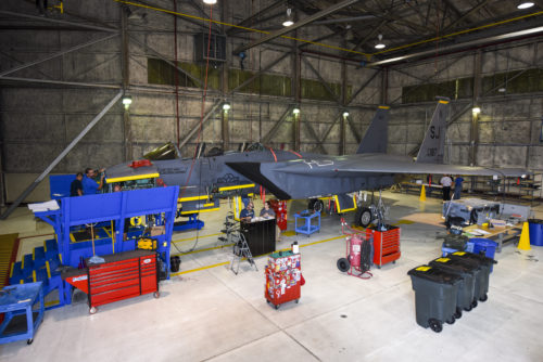 An F-15E Strike Eagle from the 336th Fighter Squadron sits in a hanger while members of the Radar Modernization Program Eagle modernization program team begin removing panels, Oct. 3, 2016, at Seymour Johnson Air Force Base, North Carolina. More than 90 jets at Seymour Johnson AFB will receive the radar modifications, projected to be completed in seven to nine years. (U.S. Air Force photo by Airman Shawna L. Keyes)