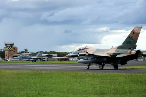 A U.S. Air Force F-16 Fighting Falcon and a Royal Australian Air Force F-18A Hornet taxi at RAAF Williamtown, during Exercise Diamond Shield 2017 in New South Wales, Australia, March 21, 2017. (U.S. Air Force photo by Tech. Sgt. Steven R. Doty)