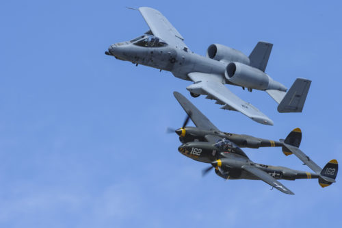 A U.S. Air Force A-10C Thunderbolt II, assigned to the 354th Fighter Squadron and a part of the A-10 West Heritage Flight Team, and a P-38 Lightning fly in formation during the Los Angeles County Air Show in Lancaster, Calif., March 26, 2017. The A-10 WHFT is scheduled to perform in 9 more air shows throughout the U.S. this year after resurging from a 5-year-long inactivation period. (U.S. Air Force photo by Airman 1st Class Mya M. Crosby)