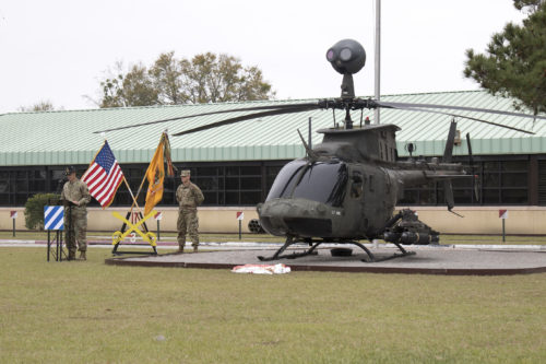 Lt. Col. Philip H. Lamb, commander, 3rd Squadron, 17th Cavalry Regiment, 3rd Combat Aviation Brigade addresses the crowd during the dedication ceremony where an OH-58D Kiowa Warrior scout helicopter joins a static display along with two other helicopters in front of the headquarters building on Hunter Army Airfield March 13. The display was dedicated to a fallen pilot Chief Warrant Officer 3 James Groves III. (Photo by Sgt. William Begley, 3rd CAB Public Affairs)
