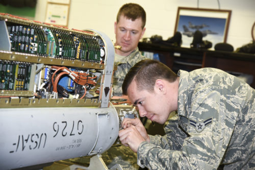 Airman 1st Class Duane Jongeling, 114th Maintenance Squadron electronic countermeasure apprentice, and Staff Sgt. Derek Jaeger, 114th Maintenance Squadron perform a routine maintenance on a electronic warfare pod. These pods are the first line of defense for the 114th Fighter Wing pilots while protecting foreign and domestic airspace. (U.S. Air National Guard photo by Staff Sgt. Duane Duimstra/Released)