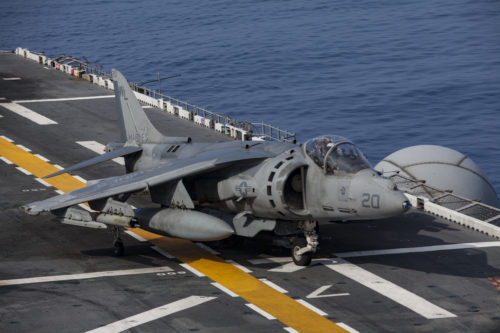 An AV-8B Harrier belonging to Marine Attack Squadron 311 taxis after landing aboard the USS Bonhomme Richard (LHD 6) while underway in the Pacific Ocean, June 9, 2017. VMA-311 is the 31st Marine Expeditionary Unit's fixed-wing attack asset and is currently attached to Marine Medium Tiltrotor Squadron 265 (Reinforced), the 31st MEU's Aviation Combat Element. During the flight the Harrier's pilot fired the Advanced Precision Kill Weapon System (APKWS), a laser-guided rocket, for the first time in the Indo-Asia-Pacific region. The 31st MEU partners with the Navy's Amphibious Squadron 11 to form amphibious component of the Bonhomme Richard Expeditionary Strike Group. The 31st MEU and PHIBRON 11 combine to provide a cohesive blue-green team capable of accomplishing a variety of missions across the Indo-Asia-Pacific. (U.S. Marine Corps photo by Lance Cpl. Stormy Mendez)