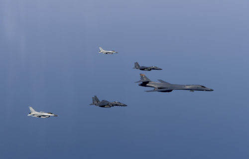 A U.S. Air Force B-1B Lancer leads a formation of Republic of Korea Air Force F-15K Slam Eagles and F-16 Fighting Falcons during a bilateral mission into South Korean airspace March 21, 2017. (DoD photo)