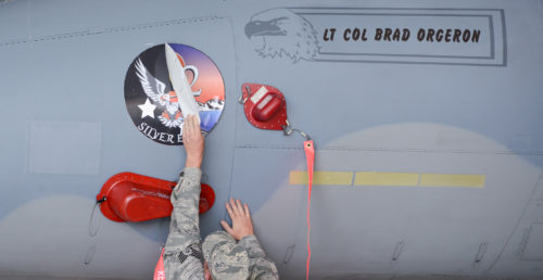 An Airman from the 550th Fighter Squadron reveals the new squadron patch during an activation ceremony, July 21, 2017, at Kingsley Field in Klamath Falls, Oregon. The active duty Air Force detachment based out of the Kingsley Field, previously known as Detachment 2, is now officially designated as the 550th Fighter Squadron. 550th Fighter Squadron members will continue to fall under the command of the 56th Operations Group at Luke Air Force Base, Arizona. (U.S. Air National Guard photo by Staff Sgt. Penny Snoozy)