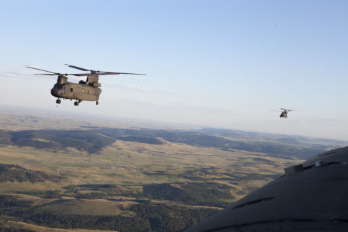 Republic of Singapore Air Force airmen fly CH-47 Chinook helicopters back to Ellsworth Air Force Base after performing sling load operations in support of the Golden Coyote training exercise at Camp Rapid, S.D., June 14, 2016. The Golden Coyote exercise is a three-phase, scenario-driven exercise conducted in the Black Hills of South Dakota and Wyoming, which enables commanders to focus on mission essential task requirements, warrior tasks and battle drills. (U.S. Army photo by Spc. Kristen Root/Released)