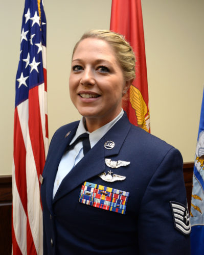 U.S. Air Force Tech. Sgt. Courtneyv poses for a photo before the 558th Flying Training Squadron's Undergraduate Remotely Piloted Aircraft Training Course graduation August 4, 2017, at Joint Base San Antonio-Randolph, Texas. Tech. Sgt. Courtney is the first-ever enlisted female to qualify as an RPA pilot. Name badges were blurred due to Air Force limits on disclosure of identifying information for RPA operators. (U.S. Air Force Illustration by Tech. Sgt. Ave I. Young)
