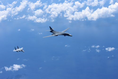 A U.S. Air Force B-1B Lancer assigned to the 37th Expeditionary Bomb Squadron, deployed from Ellsworth Air Force Base (AFB), S.D. to Andersen AFB, Guam, conducts a bilateral mission with a Japan Air Self-Defense Force F-15 in the vicinity of the Senkaku Islands, Aug. 15, 2017. These training flights with Japan demonstrate the solidarity and resolve we share with our allies to preserve peace and security in the Indo-Asia-Pacific. (Courtesy photo/Japan Air Self-Defense Force)