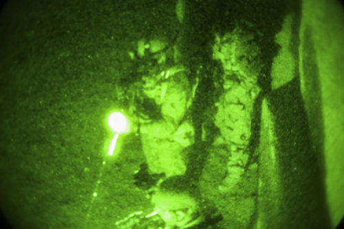 Afghan National Army soldiers with 7th Special Operations Kandak, 215th Corps conduct a notional clearing operation during night casualty evacuation training at Camp Shorabak, Afghanistan, Sept. 10, 2017. Approximately 65 soldiers with the unit rehearsed and refined their CASEVAC procedures at night with assistance from U.S. advisors in preparation for potential real-world missions. (U.S. Marine Corps photo by Sgt. Lucas Hopkins)