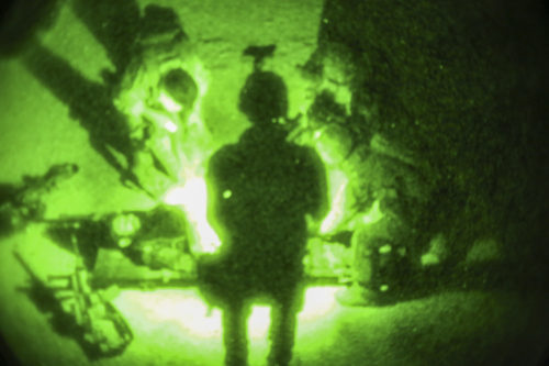 Afghan National Army soldiers with 7th Special Operations Kandak, 215th Corps provide medical care to a notionally wounded soldier during night casualty evacuation training at Camp Shorabak, Afghanistan, Sept. 10, 2017. U.S. advisors assisted their Afghan counterparts throughout the event, which focused on enhancing the soldiers' CASEVAC procedures and providing a realistic nighttime training environment to prepare the Afghans for real-world scenarios. (U.S. Marine Corps photo by Sgt. Lucas Hopkins)