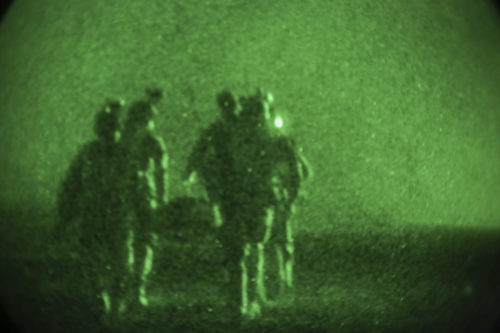 Afghan National Army soldiers with 7th Special Operations Kandak, 215th Corps carry a simulated casualty toward an Afghan Air Force Mi-17 helicopter at Camp Shorabak, Afghanistan, Sept. 10, 2017. Approximately 65 soldiers completed nighttime CASEVAC training, which focused on enhancing their procedures when faced with wounded personnel on the battlefield and providing a realistic training environment in preparation for real-world scenarios. (U.S. Marine Corps photo by Sgt. Lucas Hopkins)